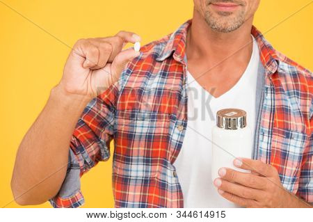 Man Drugs Jar. Unshaven Man Hold Vitamin Pill Container. Medicine Concept. Anabolic And Steroids. Fo