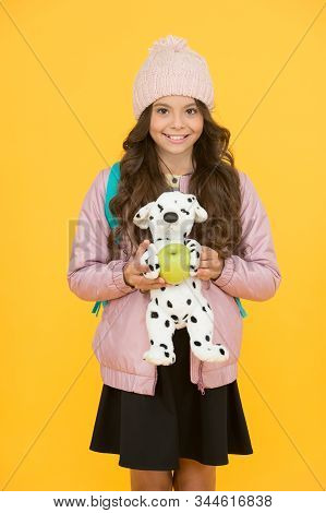 Afterschool Special. Happy Girl Go To Afterschool With Toy Dog. Little Schoolchild Yellow Background