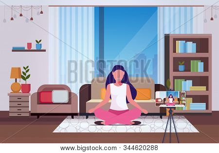 Woman Blogger Sitting On Floor Recording Video Blog With Digital Camera On Tripod Live Streaming Soc