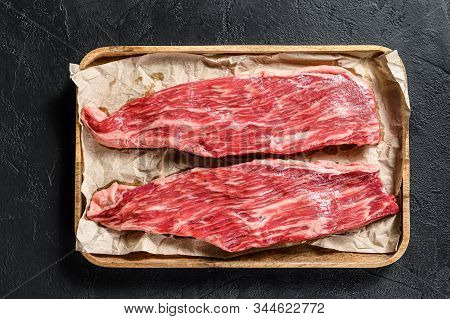 Raw Beef Steak, Flank. Marble Beef. Black Background. Top View