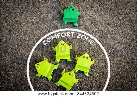Exit From The Comfort Zone Concept. Dark Green Frog Jump Out Of The Comfort Zone While Other Light G