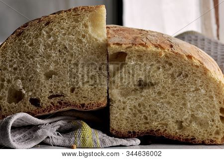 Closeup Of Freshly Baked Bread In Rustic Style/ Fresh Round Bread With A Beautiful Crust Lies On A W