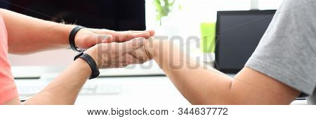 Focus On Male And Tender Female Lovers Holding Hands In Beautiful Living Room And Relaxing Near Wide