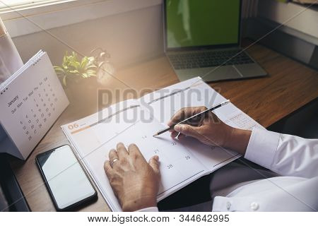 Calendar Reminder Event Concept.man Hand Planner Or Organizer Writing On Diary Book And 2020 Calenda