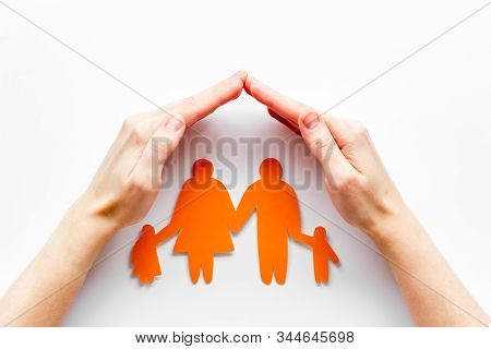 Live Insurance Concept. Family Silhouette Under Palms On White Background Top-down Copy Space