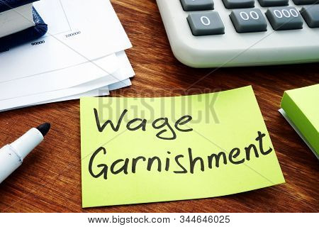 Wage Garnishment Written On The Yellow Sheet.