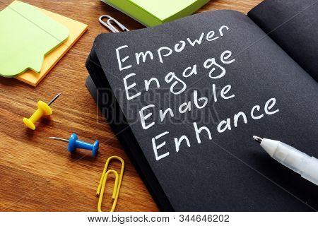 Empower Engage Enable Enhance Words Written In The Notepad.