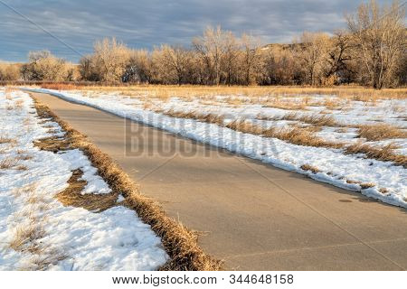 winter scenery on a bike trail - Poudre River Trail in northern Colorado, biking, recreation and commuting concept