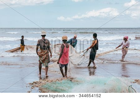 Maroantsetra, Madagascar October: 19.2016 Native Woman Fishing On Sea, Using Technique Pulling Net F