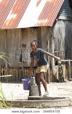 Maroantsetra, Madagascar October 20.2016: Malagasy Girl Goes For Water To A Public Pump In Middle Of