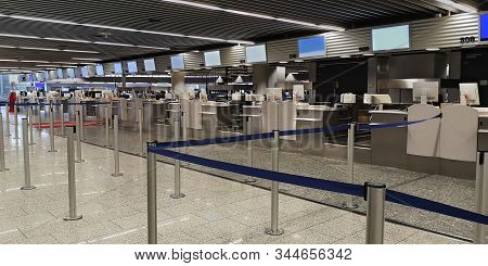 Frankfurt, Germany-12 26 2019:empty Check-in Counters With Computers, Monitors, Luggage Scales, Drop