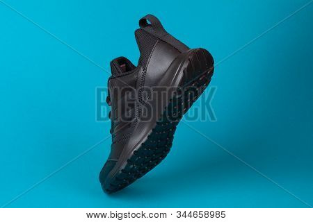 Varna , Bulgaria - August 13, 2019 : Adidas Sport Shoe, On Blue Background. Product Shot. Adidas Is