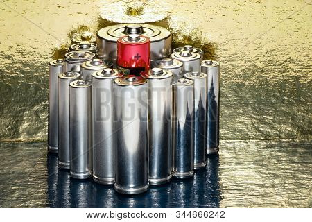 Several Batteries Of Type Aa, Aaa, D In Perspective Close-up On A Gold Background.