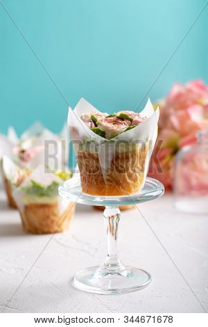 Flower Cupcake On White Blue Background. Beautiful Sponge Cup Cakes Decorated With Buttercream Roses