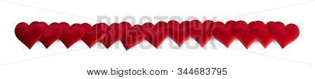 Valentine's day many red silk hearts stripe isolated on white background, love concept