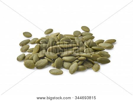 A Pile Of Peeled Pumpkin Seeds Isolated On White Background