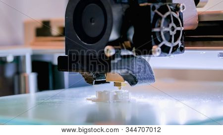 Print Head Of 3d Printer Machine Printing Plastic Model At Modern Scifi Technology Exhibition. 3d Pr