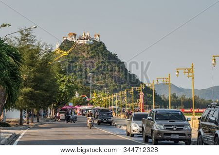 Prachuap Khiri Khan, Thailand - February 9, 2019: Promenade by the sea with monkey hill at background in Prachuap Khiri Khan, Thailand.