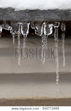 Snow Covered Roof With Icicles. Cold Weather, Winter Season Concept, Soft Focus, Shallow Depth Field