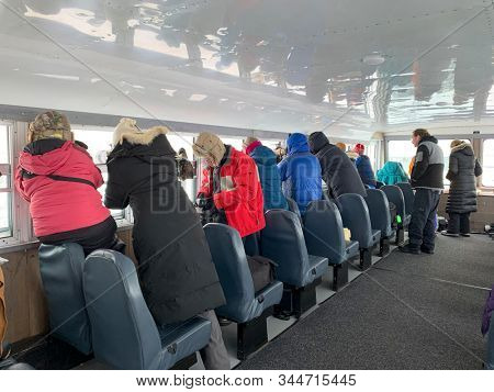 CHURCHILL, MANITOBA/CANADA - November 10, 2019:  Tundra Buggies provide transportation for the safe viewing of polar bears.  People inside view the bears safely from the windows or the back deck.