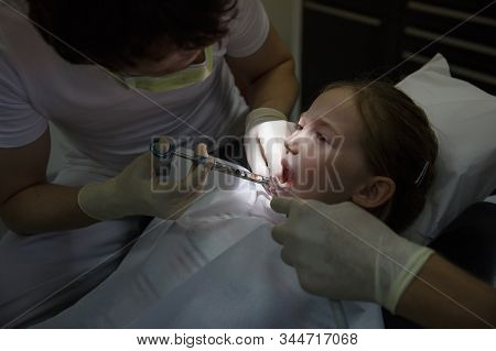 Little Girl At Dentist Office, Getting Local Anesthesia Injection Into Gums, Dentist Numbing Gums Fo