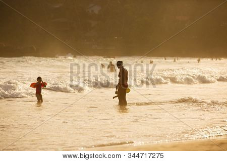 Silhouette Of Mother Enjoying A Tropical Beach With Her Children. Travelling With Children, Beach Ho