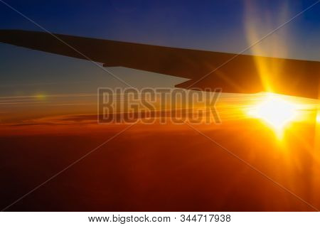 Sky and clouds sunset time at stratosphere from airplane window abstract background