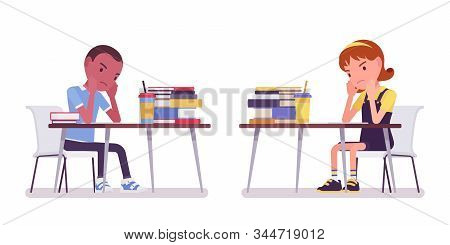 School Boy And Girl At Desk Tired With Study. Sad Cute Small Children Busy At Lesson, Active Young K