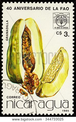 Moscow, Russia - January 09, 2020: Stamp Printed In Nicaragua Shows Passion Fruit Or Passiflora, Ded