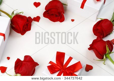 Red rose flowers gifts hearts and gifts composition isolated on white background top view with copy space. Valentine's day, birthday, wedding, Mother's day concept. Copy space