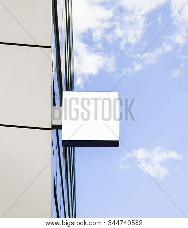 Blank White Square Sign On Glas Wall Mockup, Sky Background