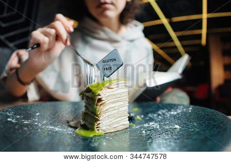Closeup Of Woman Eating Cake With Gluten Free Text Sign