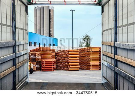 Loading The Truck. Forklift Loading A Trailer . Unloading Big Container Trucks At Warehouse Building