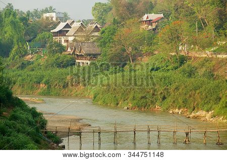 Luang Prabang, Laos - April 12, 2012: View To The Residential Area Of The City Across The River With
