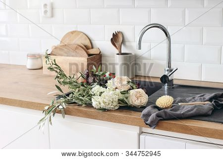 Closeup Of Kitchen Interior. White Brick Wall, Metro Tiles, Wooden Countertops With Kitchen Utensils