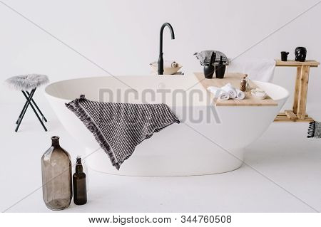 Stylish Bathroom And Beautiful Oval Bath. White Walls And Modern Bathroom. Spa And Relax Concept