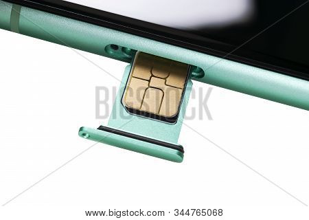 Modern Mobile Phone And Sim Card Isolated On A White Background. Smartphone With Nano Sim Card And C