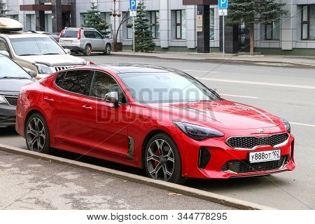 Ufa, Russia - October 10, 2019: Red Sports Car Kia Stinger In The City Street.