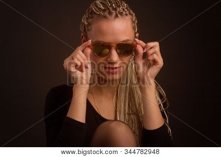 Fashion Studio Shoot Woman With A Creative Colorful Hairstyle In The Form Of A Pigtail Braided From