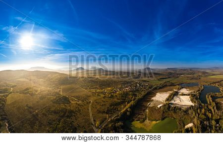 Hungarian stone mine landscape panorama by drone lensflare fall, autumn.