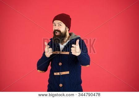 Winter Menswear. Clothes Design. Man Bearded Warm Jumper And Hat Red Background. Winter Season Mensw
