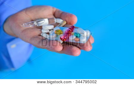 Medicine Pills In Hand. Tablets In Hand Of Patient. Medical Concept. Hand Of Man Holds Different Pil