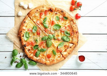 Delicious Pizza Margherita On Wooden Background. Pizza With Mushrooms