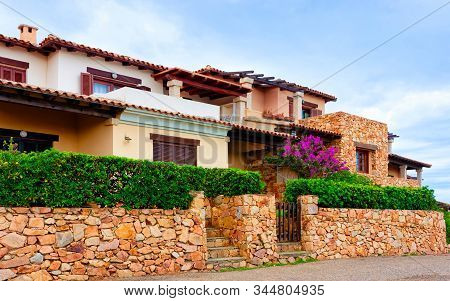 Scenery With House And Cottage At Capo Coda Cavallo Reflex