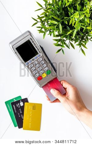 Payments In Shops. Hand Insert Bank Card In Terminal On White Background Top-down