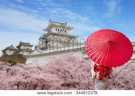 Asian Young Woman Traveller Wearing Japanese Traditional Kimono With Red Umbrella Sightseeing At Fam