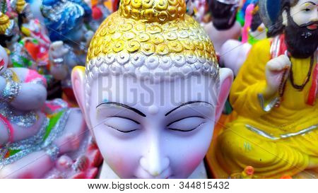 Lord Gotam Buddha Statue With Colsed Eyes In Back Other Statue