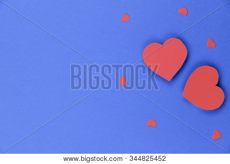 Blue Background With Red Hearts. Valentine Day Background. Two Big Red Hearts And A Few Small Ones O