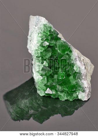 macro photo of green emerald druse on dark background
