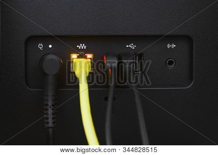 Close Up Yellow Lan Or Network Cable Connected To A Lan Port Of Personal Computer (pc), Computer Con